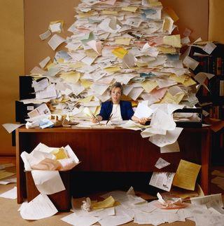 Messy-desk-big-pile